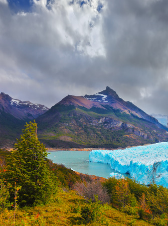 Sunny summer day in February. Los Glaciares National Park in Patagonia. Colossal Perito Moreno glacier in Lake Argentino
