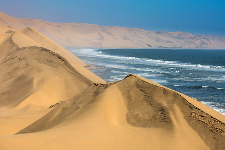 The concept of extreme and exotic tourism. Ocean surf with foamy waves. Gorgeous  Walvis Bay, Namibia, south of Africa Stock fotó