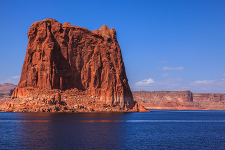 surrounded: Lake Powell is surrounded by magnificent sandstone hills. Boat trip on a sunny day. Scenic huge artificial water basin of the Colorado River, USA