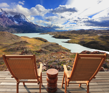 Wooden chairs in the Chilean national park Torres del Paine. Pleasant holiday