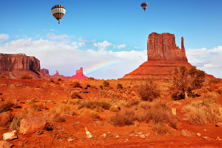 Navajo Reservation in Arizona and Utah. Stone desert and rocks - mitts of red sandstone. Fly over the valley huge balloons