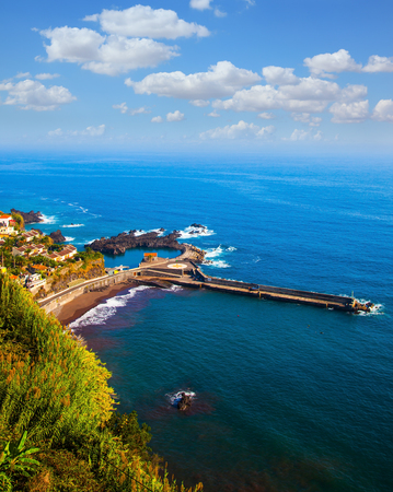 The magical tropical island of Madeira. Picturesque village and boat pier on the cape Stock fotó