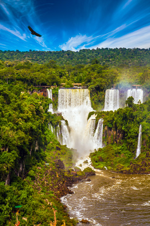 The fantastic Iguazu Falls in South America, on the border of three countries: Brazil, Argentina and Paraguay. Concept of active and extreme tourism Stock Photo