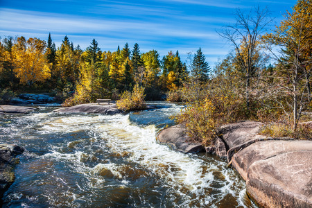 The old dam Pinava. Warm clear autumn day of the Winnipeg River. The concept of ecological and adventure tourism.