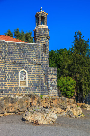 The Holy Church was built on the Sea of Galilee. The Church of the Primacy - Tabgha. Jesus then fed with bread and fish hungry people Stock Photo