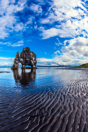 The concept of extreme northern tourism. The famous rock Hvitserkur in the form of a huge mammoth. The north coast of Iceland Stock Photo