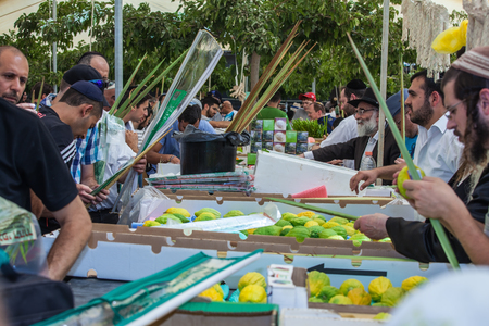 JERUSALEM, ISRAEL - OCTOBER 8, 2014: Sukkot in Israel. Jews buy four ritual plants. Суккот in Israel. A traditional holiday market in Jerusalem