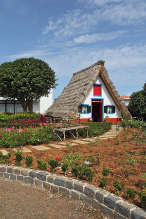 Cosy chalet with a triangular thatched roof. Madeira Island, the city Santana