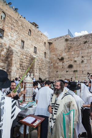 jewish: JERUSALEM, ISRAEL - OCTOBER 12, 2014:  Morning autumn Sukkot. Crowd of Jewish worshipers in white wearing prayer shawls. The area of Western Wall of  Temple filled with people