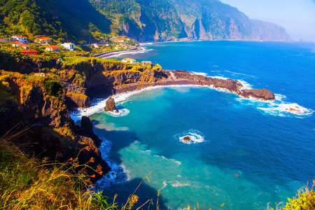 smooth: Aerial view of a calm bay with azure water. Volcanic island of Madeira. Grottoes and rocks of the Atlantic coast. The concept of ecological and exotic tourism Stock Photo