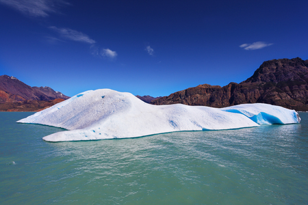 Huge white-blue icebergs float in ice emerald waters of the lake in Argentina.  The unique lake Viedma  in droughty Patagonia Stock Photo