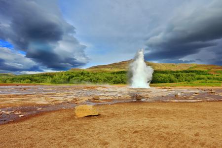 Geyser Strokkur erupts every few minutes. Famous geyser Strokkur in Iceland