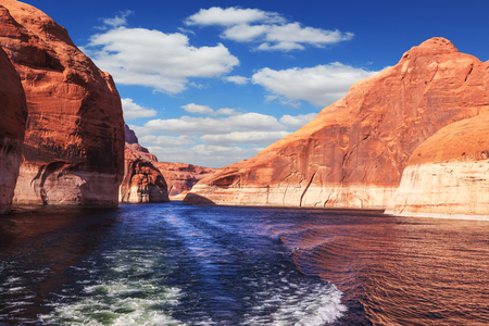 The lake Powell on river Colorado. The foamy trace from powerboat crosses emerald waters. Hills from red sandstone surround the lake Reklamní fotografie
