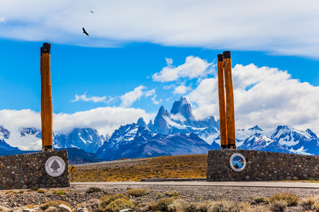 Symbolic columns at the entrance to Los Glaciares National Park. Fine highway to the grandiose Mount Fitz Roy. Patagonian pampas. The concept of active and ecological tourism