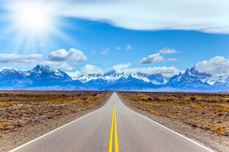 Fine highway to the grandiose Mount Fitz Roy. Argentine Patagonia. Summer day in February. The concept of active and extreme tourism. The summer sun illuminates the prairie
