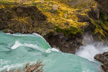 パタゴニアへの旅行します。青緑色の水は、強力な滝サルト ・ グランデです。アクティブおよび生態学的な観光事業の概念 写真素材