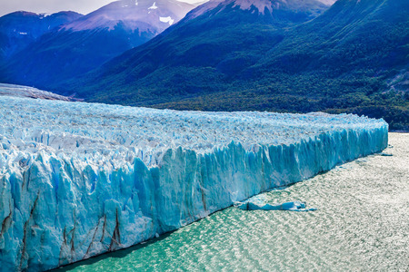 The fantastic glacier Perito Moreno, in the Patagonia. The concept of exotic and extreme tourism. Argentine Province of Santa Cruz, lake Argentine