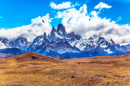 roy: Desert and mountains. The famous ridge Mount Fitz Roy and the Patagonian prairie. Argentine Patagonia. The concept of active and extreme tourism