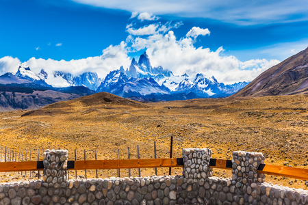 Desert and mountains. The famous ridge Mount Fitz Roy and the Patagonian pampas. Argentine Patagonia. The concept of active and extreme tourism