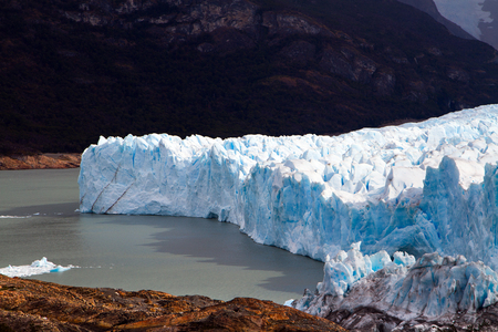 The fantastic glacier Perito Moreno, in the lake Argentine, Patagonia. The glacier shine with reflected sunlight. The concept of exotic and extreme tourism