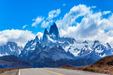 Fine highway to the grandiose Mount Fitz Roy. Argentine Patagonia. Summer sun and blue sky above the prairie. The concept of active and extreme tourism Stock Photo