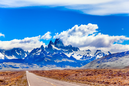 Fine highway to the grandiose Mount Fitz Roy. Argentine Patagonia. Summer day in February. The concept of active and extreme tourism. Summer sun and blue sky above the prairie