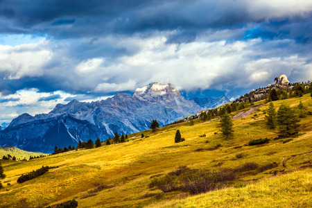 Travel in the Dolomites. Falzarego pass. Approaching snowstorm. Last sunny autumn day. The concept of active and adventure tourism Stock Photo