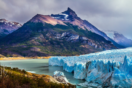 Patagonian province of Santa Cruz, Lake Argentino. On the surface of the glacier Perito Moreno formed Calgaspors - penitent firn.  The concept of exotic and extreme tourism