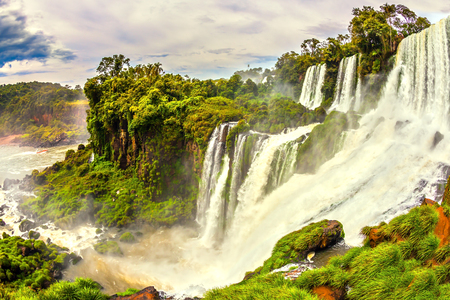 The most famous waterfalls in the world - Iguazu. The waterfalls erupts clouds of water spray. The concept of active and exotic tourism Reklamní fotografie