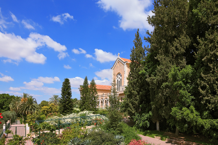 Israel. The monastery - Latrun. The magnificent building of the temple is surrounded by a lush garden