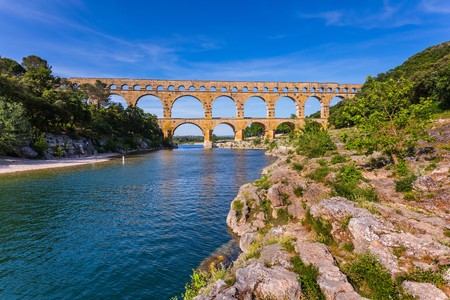 Three-storied aqueduct of Pont du Gard - the highest in Europe. The bridge was built at the time of Roman Empire on river Gardon. Provence, spring sunny day Banco de Imagens