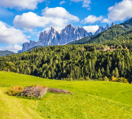 Warm autumn in the Dolomites, the Val de Funes. The valley is surrounded by a dentate wall of dolomite rocks. The concept of ecological tourism Stock Photo
