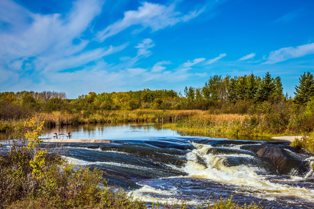 The concept of travel Around the World. Old Pinawa Dam Park. Magnificent rapids on the smooth stones of the Winnipeg River