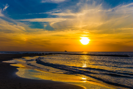 Warm winter in Israel. Bright  sunset on the Mediterranean coast in Caesarea. Concept of ecological tourism