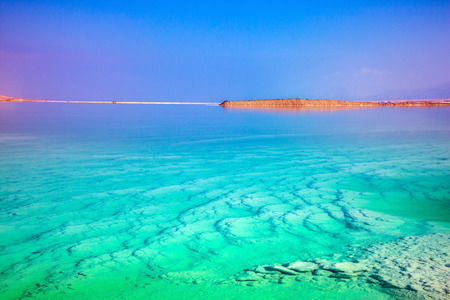 Midday heat evaporates water. Turquoise water of the Dead Sea, Israel. The concept of medical and ecological tourism