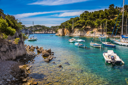 National park of Calanques in Provence, between Marseille and Kassis. The picturesque gulf with turquoise water at coast of the Mediterranean Sea. Graceful sailing yachts in the sea fjord