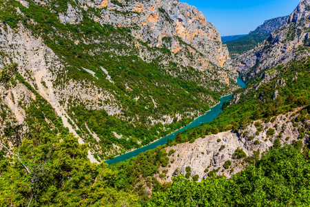 Magnificent gorge Verdon in the French Alps. The river Verdon flows along the bottom of the canyon. The dangerous steep slopes of the canyon. Concept of active and extreme tourism