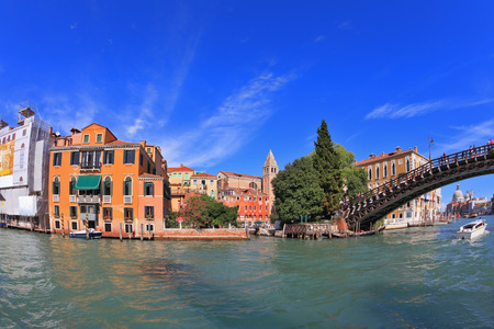 Wonderful holiday in Venice. Ornate facades perfectly restored antique palaces lit setting sun. Graceful bridge spans the Grand Canal. Photo taken by lens Fisheye Stock Photo