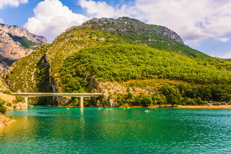 The picturesque Verdon Gorge in the Mercantour Park. Brightly green river water. Big bridge across the canyon and river Verdon. The concept of active and ecotourism