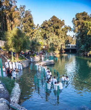YARDENIT, ISRAEL - JANUARY 21, 2012: Christian pilgrims enter Jordan River waters. Christian pilgrims make here baptized in honor of the baptism of Jesus Christ Editorial