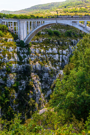 Grandiose bridge over the mountain canyon Verdon, Southern France, Provence. The picturesque  Verdon Gorge in the Mercantour Park. The concept of active and extreme tourism