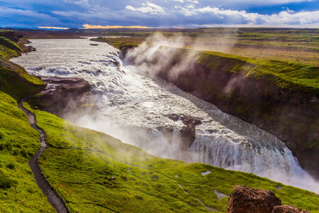Gullfoss - Golden Waterfall in Iceland. Falls on the Hvitau River. Cloudy and foggy July day. The concept of extreme and phototourism 写真素材