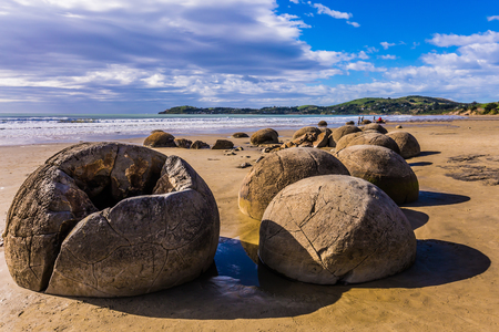 Travel to New Zealand. Boulders Moeraki - a group of large spherical boulders on the beach Koekokhe. The concept of active, eco and photo - tourism