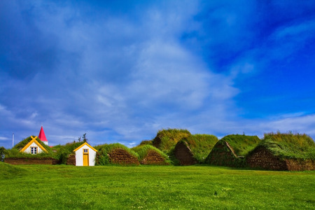 The recreated village - the museum of pioneers - Vikings. The village of ancestors in Iceland. Houses are roofed by the turf Editorial