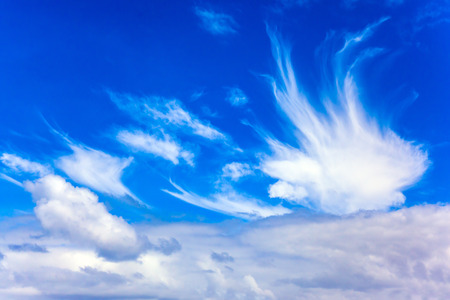 Cirrostratus cllouds of fanciful shapes in the blue sky of Australia. Journey to the ends of the earth. The concept of photo and ecological tourism
