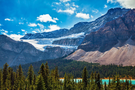 Canada, Rocky Mountains, Alberta, Banff National Park. The Glacier Crowfoot over Bow River  in an environment of bright striped mountains