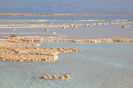 The shoaled Dead Sea at coast of Israel.  Fused salt out of the water