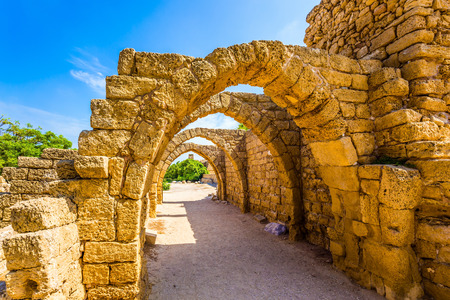 Ruins of the ancient city of Caesarea. Israel. Sunny spring day. Arched passage - covered street of Port of Caesarea. Concept of ecological and historical tourism Фото со стока - 105518751