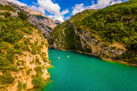 Fascinating journey along the mountain river. The Provence Alps, France. The Verdon River flow between the sheer cliffs of Verdon Canyon. Concept of ecological and active tourism