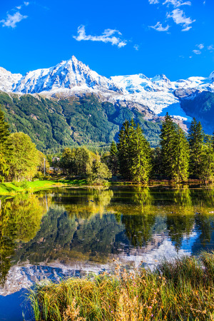 Wonderful sunny autumn day in the French Alps. Chamonix City Park is illuminated by sunset. Concept of active winter tourism Stock Photo